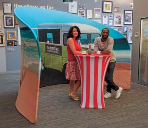 Printed fabric cocktail tables for outdoor display