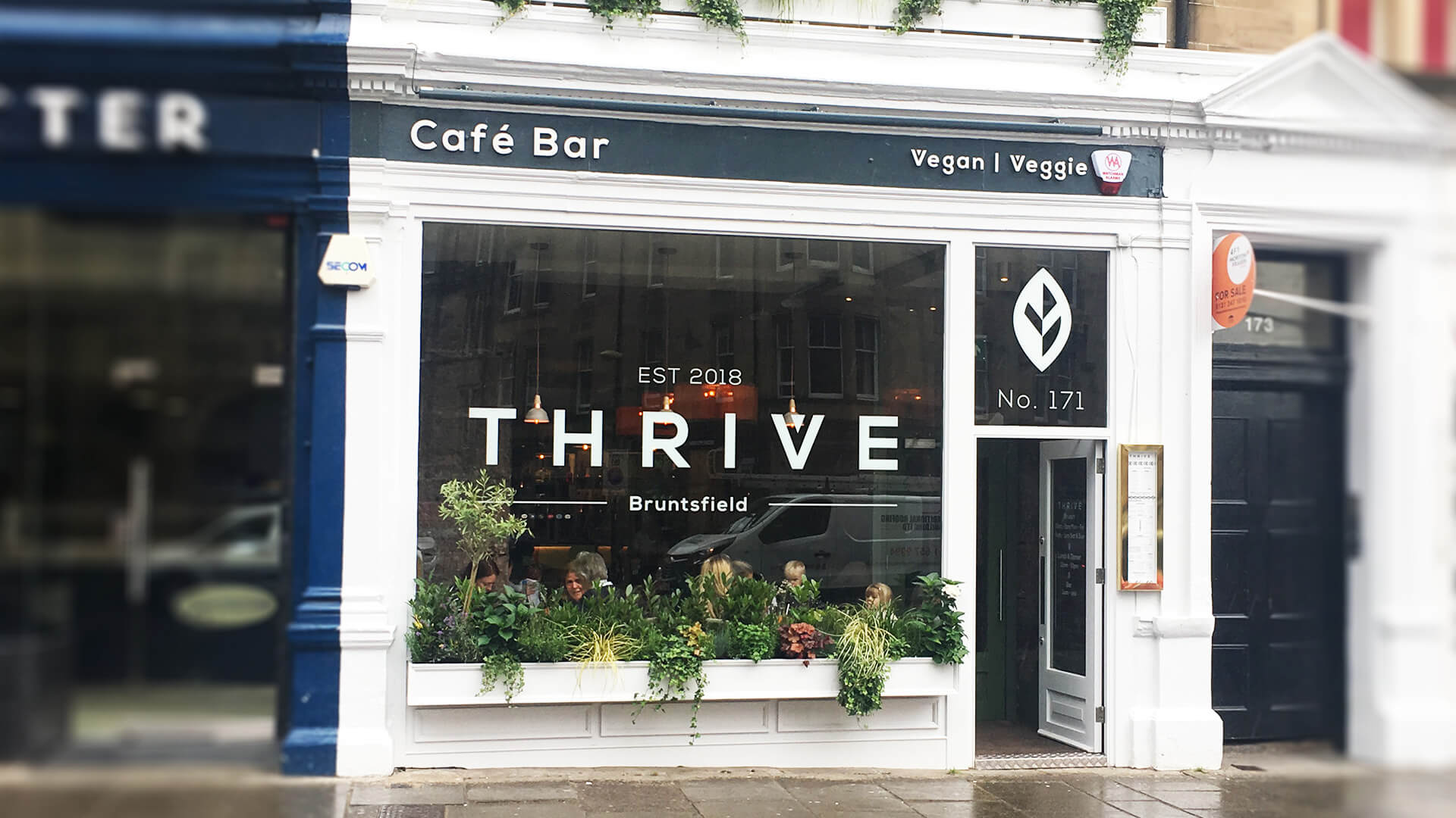 Photo of exterior vegan bar branding & signage